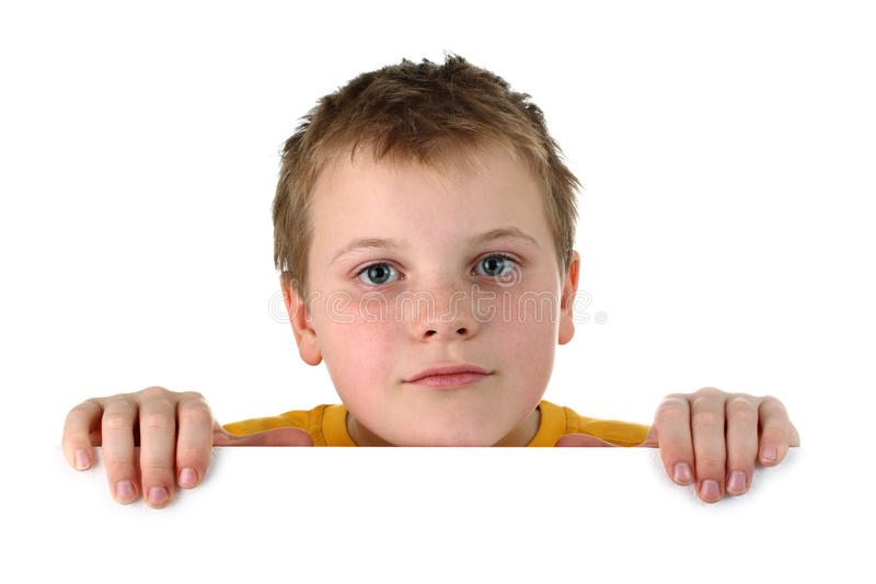 Small Boy Looking Out Of A Blank Whiteboard Royalty Free Stock Image