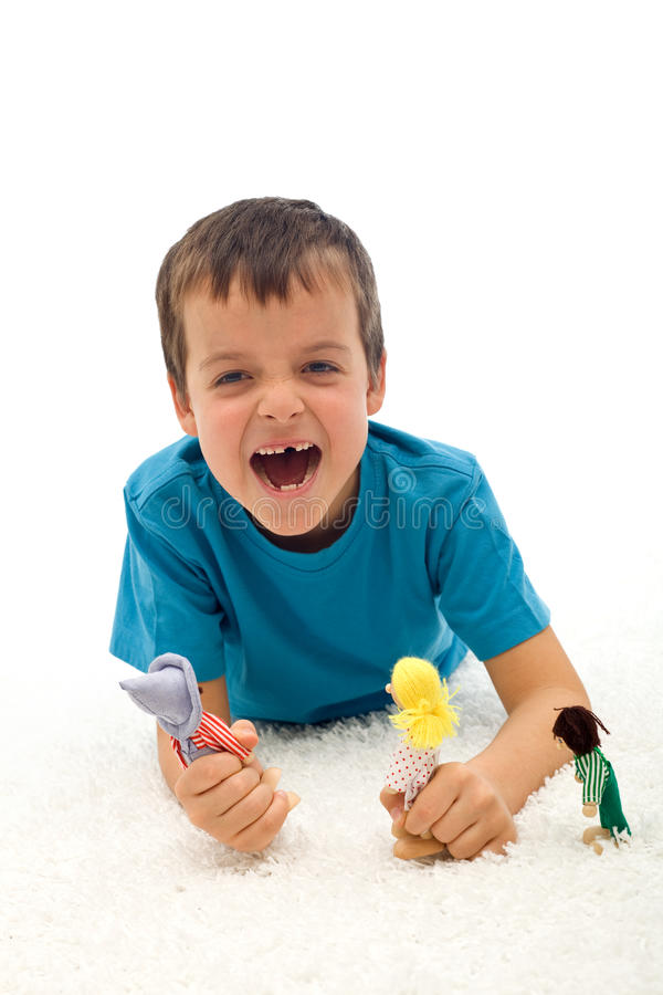 Download Small Boy Playing Aggressive Game With Puppets Stock Image - Image of show, white: 17942423