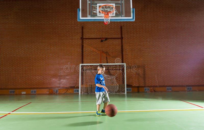 Small boy playing basketball stock photos