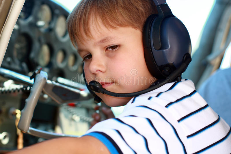 Download Small Boy Playing Pilot In Airplane Stock Photo - Image: 15465164