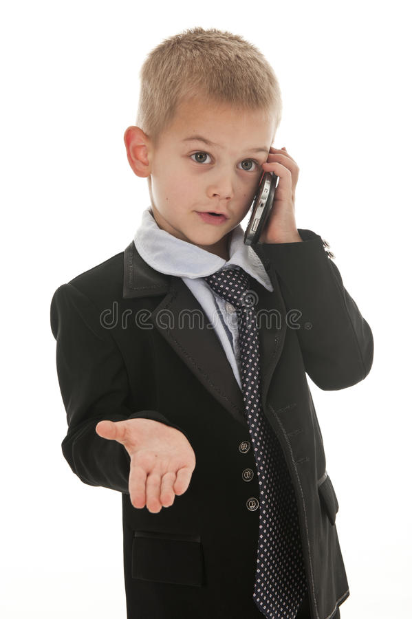 Download A Small Boy Pretending To Be A Businessman. Stock Photo - Image: 15021896