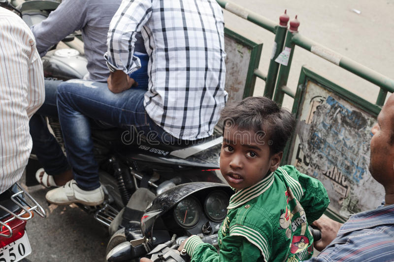 Small boy riding on a bike with family. VARANASI, INDIA - OCTOBER 28: Small boy riding on a bike with family. Motorbike is the most favorite vehicle and most stock images