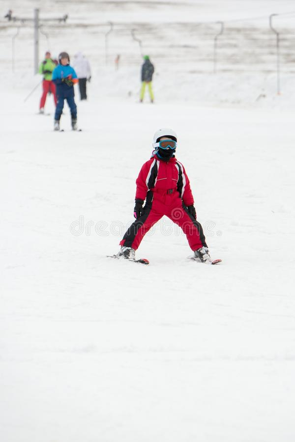 Small boy in ski mask and helmet learns skiing. Winter snow landscape. Cicmany, Slovakia stock images