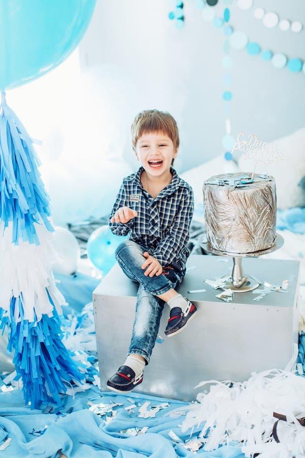 small boy smiling looking at camera stock photo
