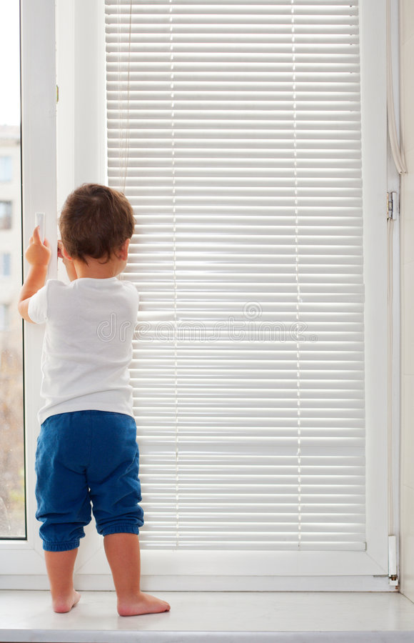 Small Boy Standing On Window Sill Royalty Free Stock Image