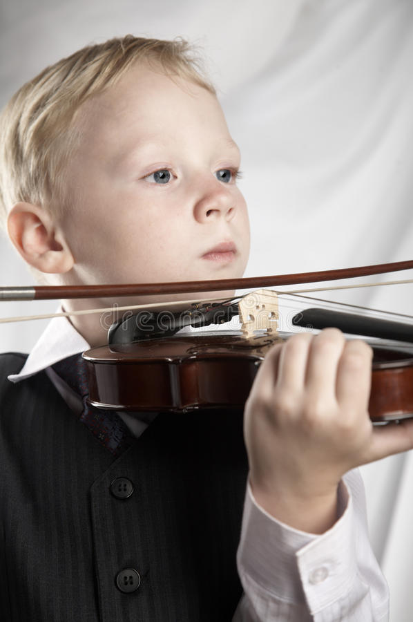 Small boy with a violin stock photos