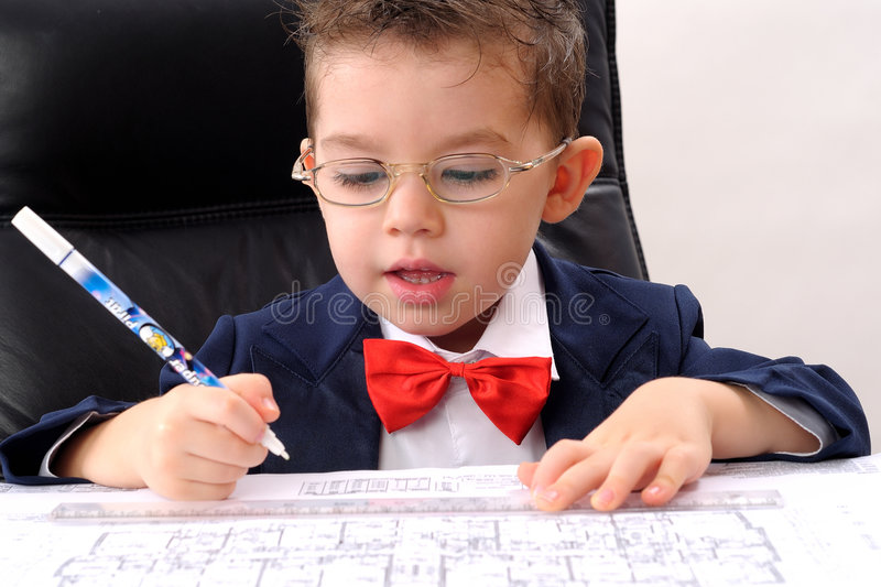 small boy writing and studying architecture stock photo