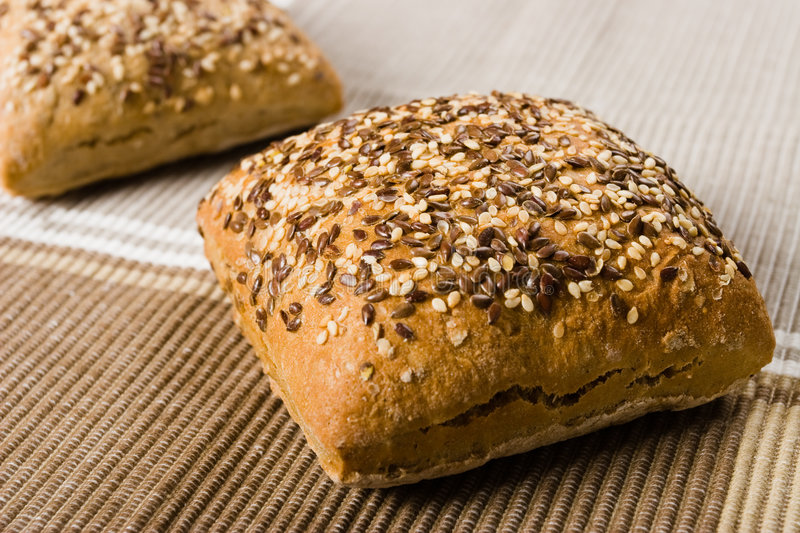 Small bread. S with sesame seeds stock photos