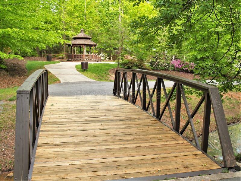 C. G. Hill Memorial Park. Small bridge along a walking trail leads to a gazebo at C. G. Hill Memorial Park in Pfafftown, North Carolina stock photo
