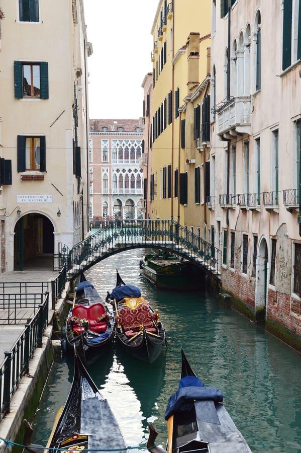Small bridge and gondolas stock image