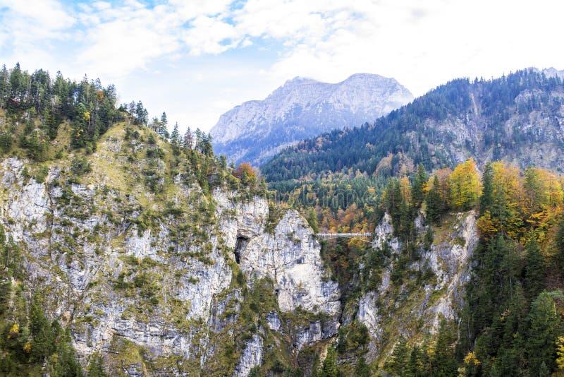 Small bridge between steep rocks Castle Neuschwanstein stock photography