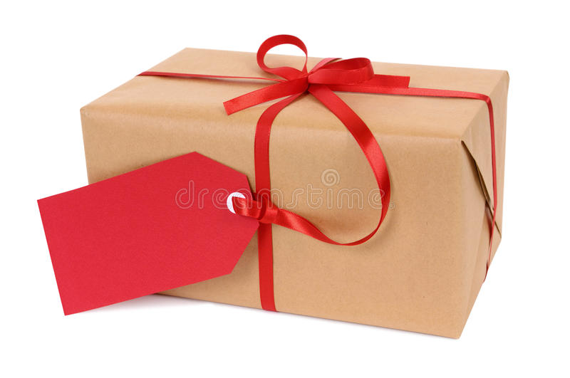 Small brown paper package or gift tied with red ribbon and gift tag isolated on white background. Brown paper package or gift tied with red ribbon and gift tag stock photos