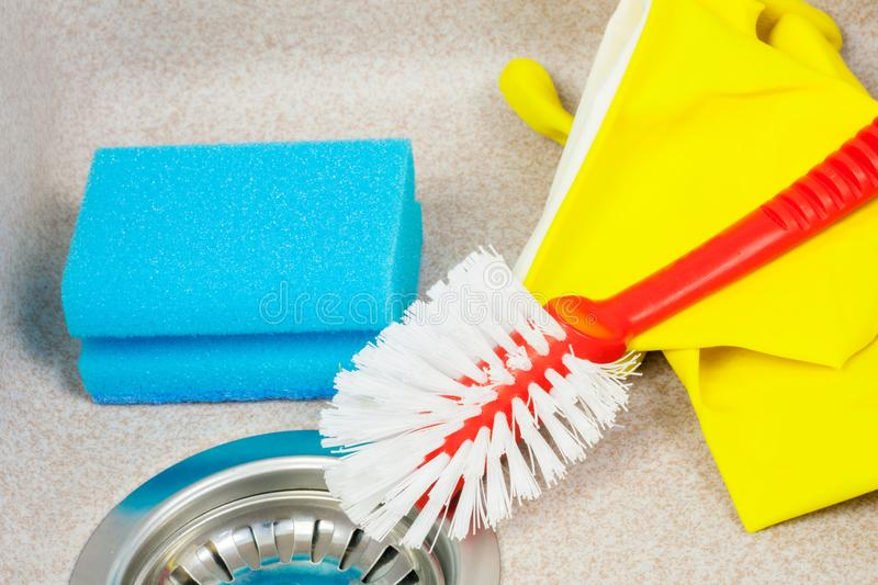 Small brush and sponge in kitchen sink stock photos