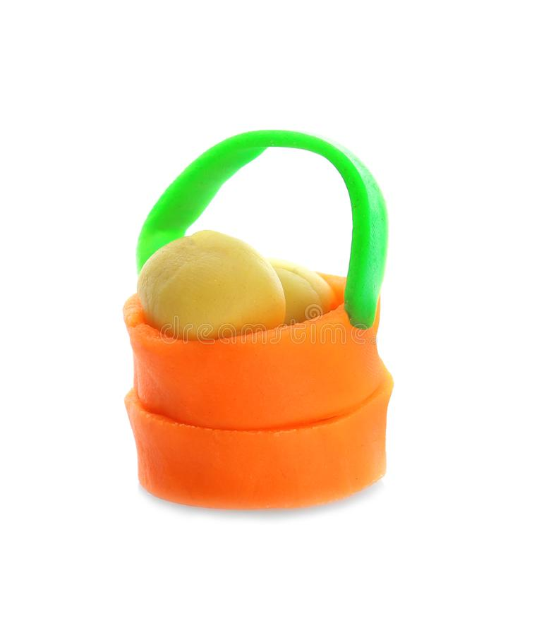 Small bucket made from play dough. On white background stock image