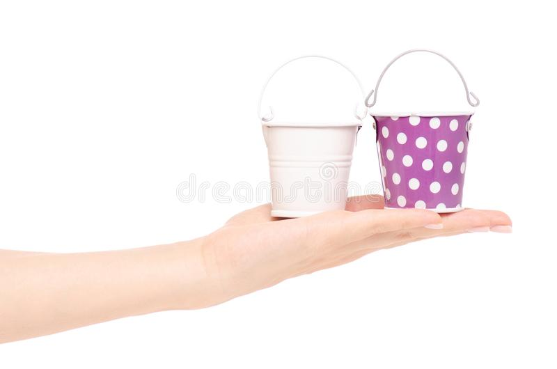 Small buckets in a hand. On a white background isolation royalty free stock photo