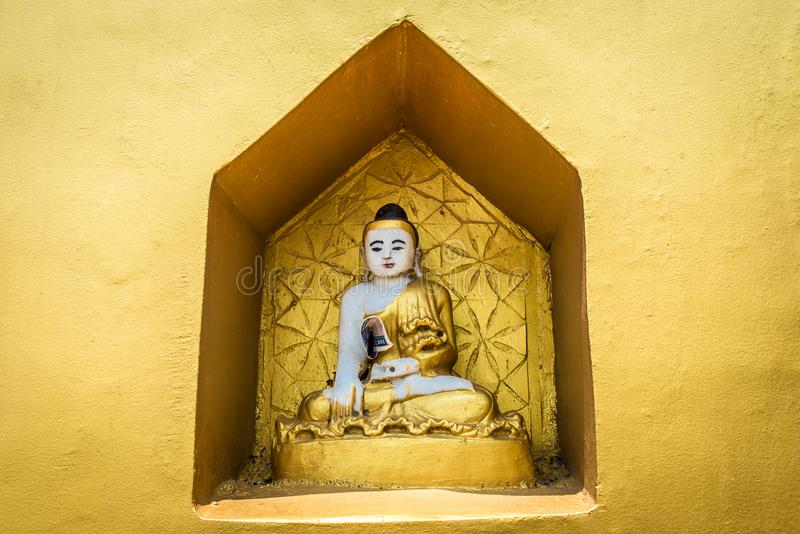 A small Buddhist altar with Buddha statues. stock photo