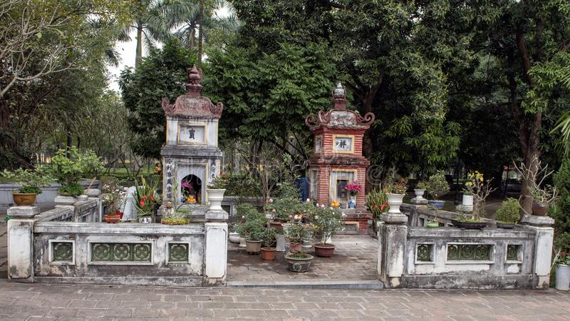 Small Buddhist shrines near the One Pillar Pagoda, Hanoi, Vietnam. Pictured are two small Buddhist shrines near the One Pillar Pagoda, Hanoi, capital of Vietnam royalty free stock images