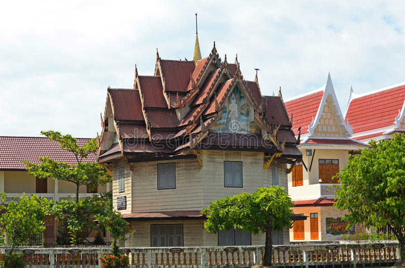 Small Buddhist temple in the Thai town stock image