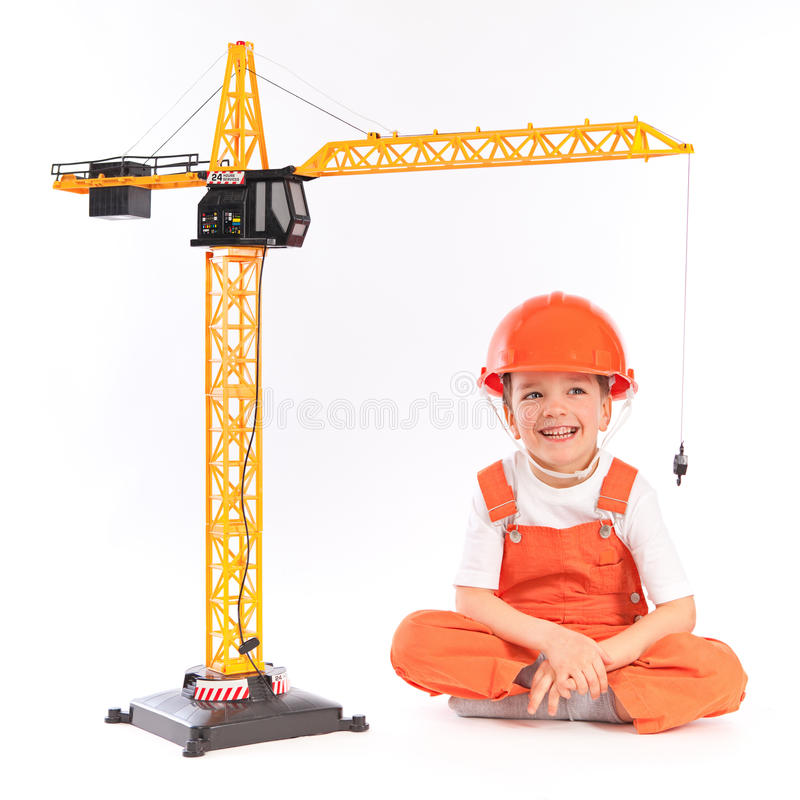 Small builder and crane on white background royalty free stock images
