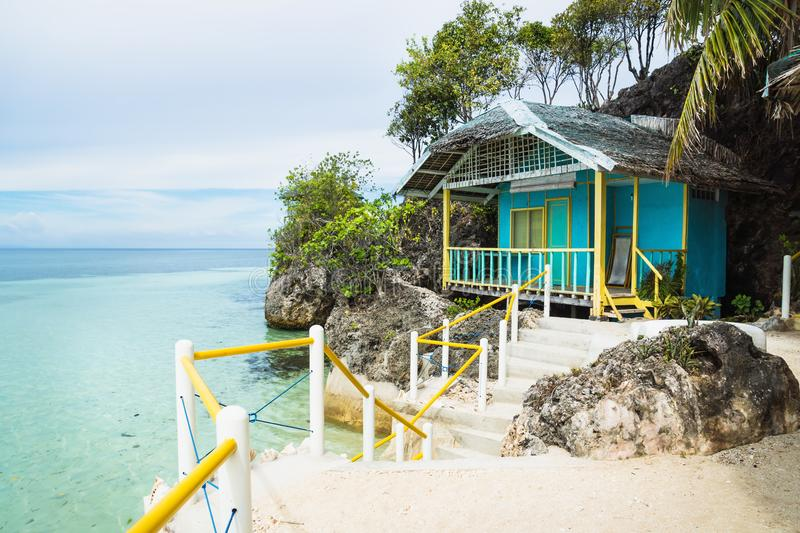 Small Bungalow at the ocean of Siquijor, Philippines, Asia. Small turquoise Bungalow at the ocean of Siquijor, Philippines, Asia royalty free stock photos