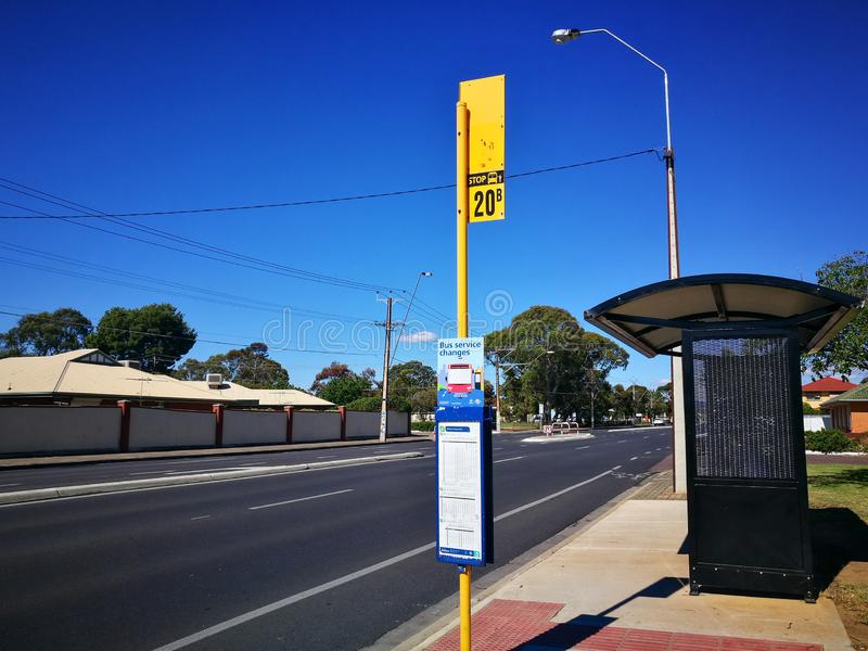 The Small bus stop in rural town with blue sky day. stock image