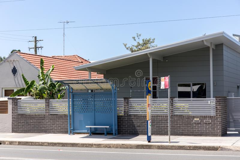 The Small bus stop in rural town with blue sky day. royalty free stock image