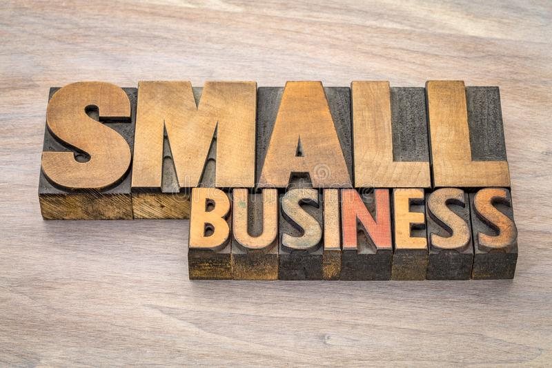 Small business banner in letterpress wood type stock images