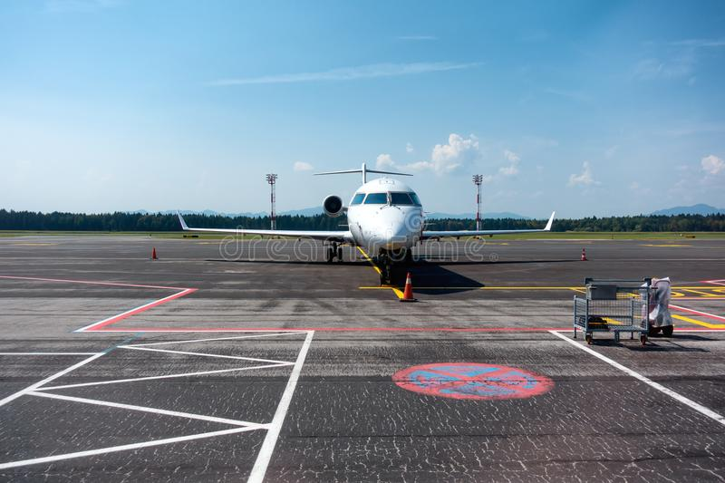 Small business, commuter jet airplane on airport stock photo