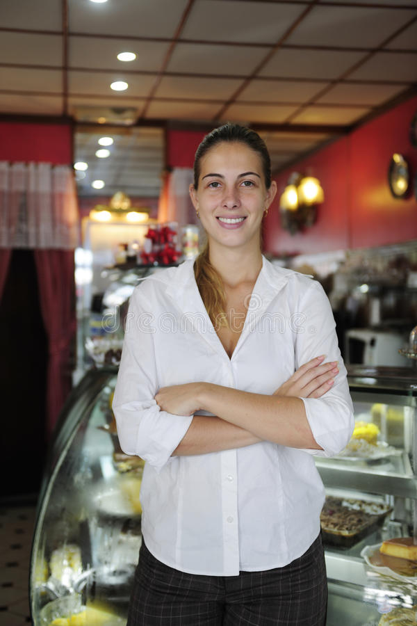 Small business: female owner of a cafe. Small business: proud female owner of a cafe royalty free stock photos