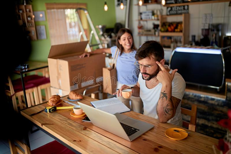Small business man owner in coffee shop stock photos
