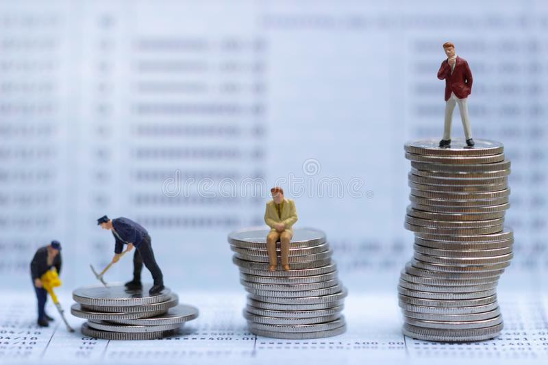 Small business mans figures standing on turning point on bank passbook. Retirement planning. Investment and money saving. retirement communities. Business royalty free stock images