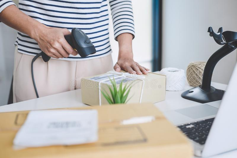 Small business owner delivery service and working packing box, business owner working checking order to confirm before sending. Customer in post office stock images