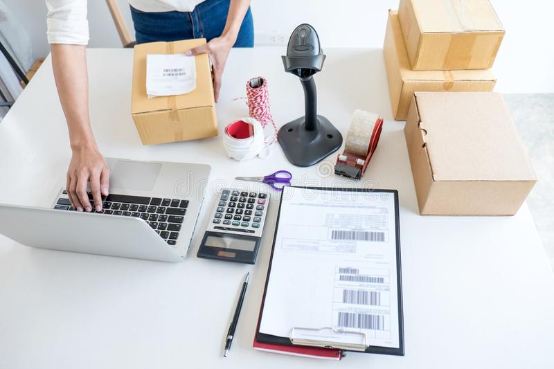 Small business owner delivery service and working packing box, business owner working checking order to confirm before sending. Customer in post office stock photos