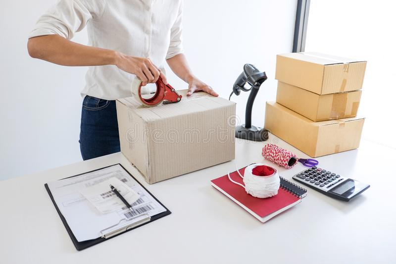 Small business owner delivery service and working packing box, business owner working checking order to confirm before sending. Customer in post office royalty free stock photos