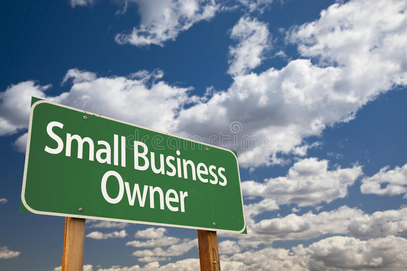 Small Business Owner Green Road Sign and Clouds royalty free stock photo