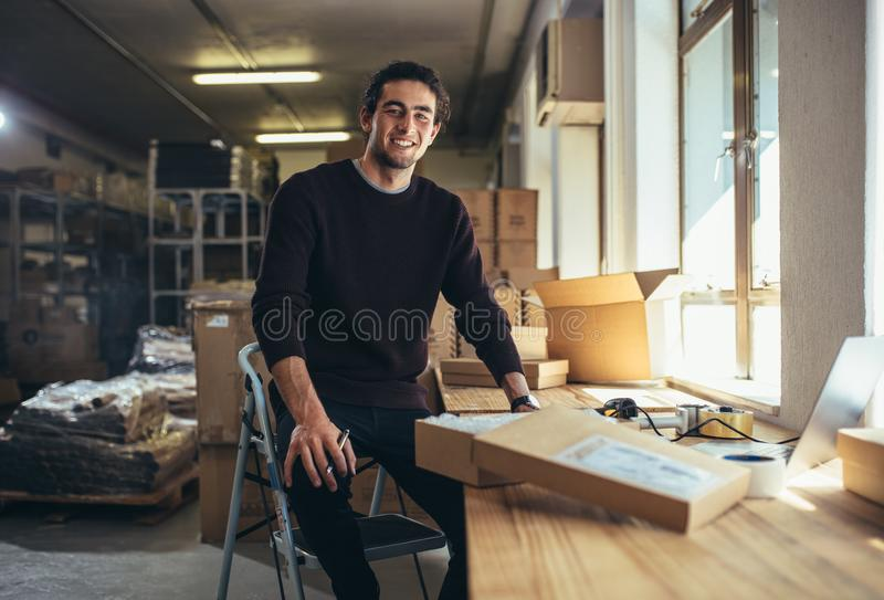 Small business owner at his work desk royalty free stock photo