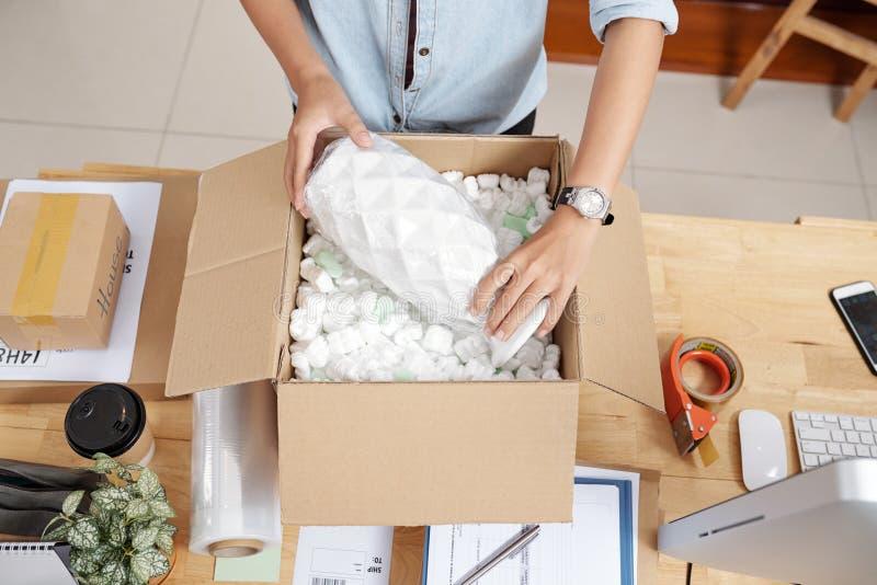 Woman packing vase royalty free stock image