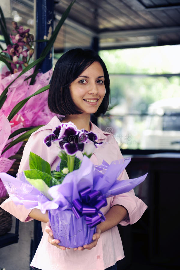 Small business owner: woman and her flower shop royalty free stock image