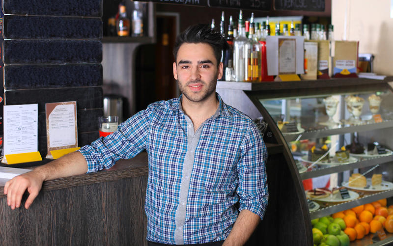 Small business owner working at cafe stock photos
