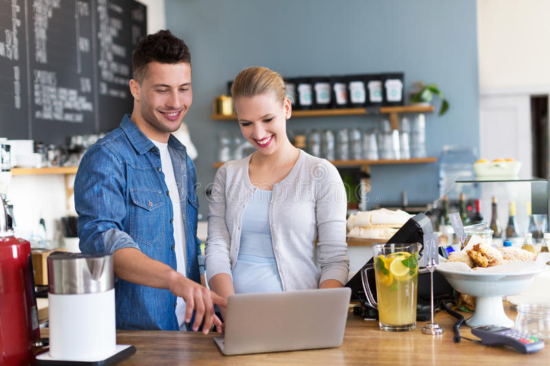 Small business owners in coffee shop stock photos