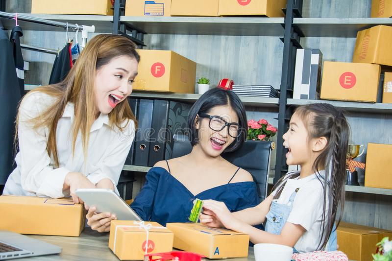 Small business owners use houses to work receiving and sending products to customers,Consisting mother and two daughters product. Orders confirmed by customers stock image
