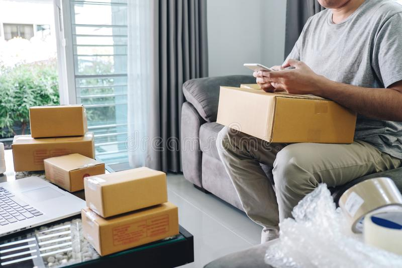 Small business parcel for shipment to client at home, Young entrepreneur SME freelance man working online business by using smart stock photos