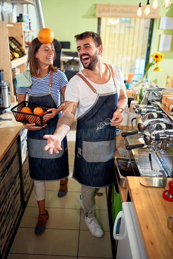 Small business, people and service concept - man or waiter in apron at bar or coffee shop royalty free stock photo