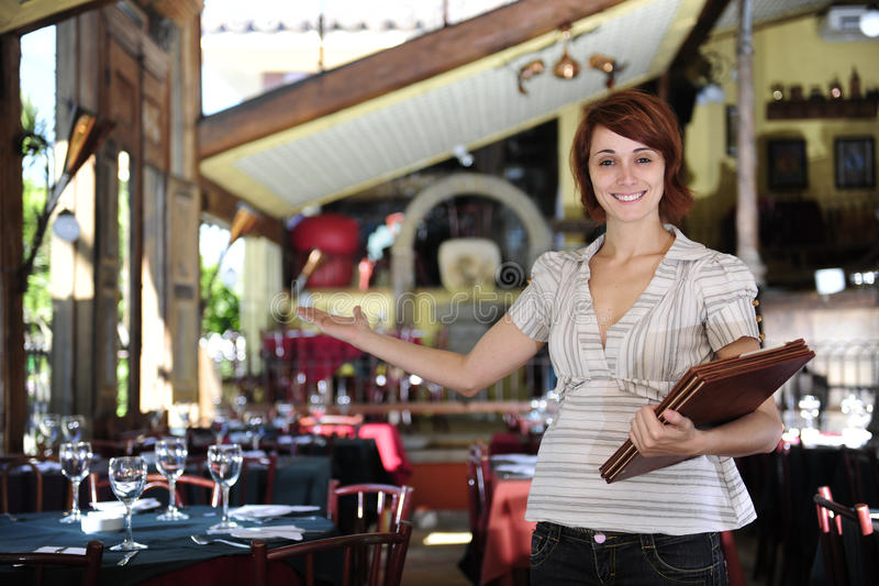 Small business: proud female owner of a restaurant. With copy space stock photos