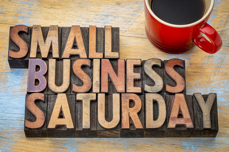 Small Business Saturday in wood type stock images