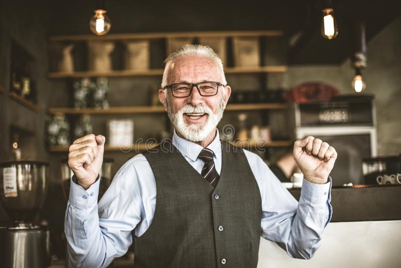 Small business. Senior businessman feel good stock images