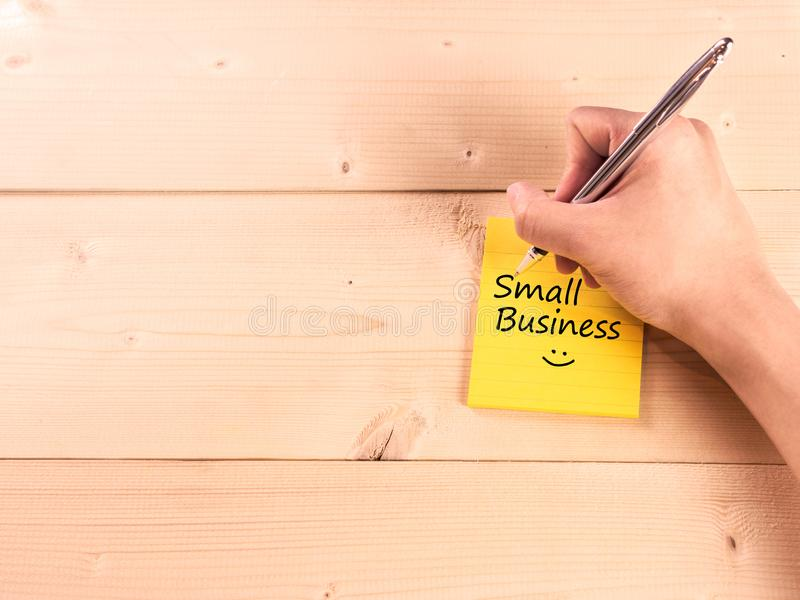 Small business with smiley face on sticky note.  royalty free stock photography