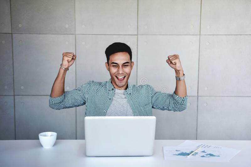 Small Business and Successful Concept. Young Asian Businessman Glad to receive a Good News stock image