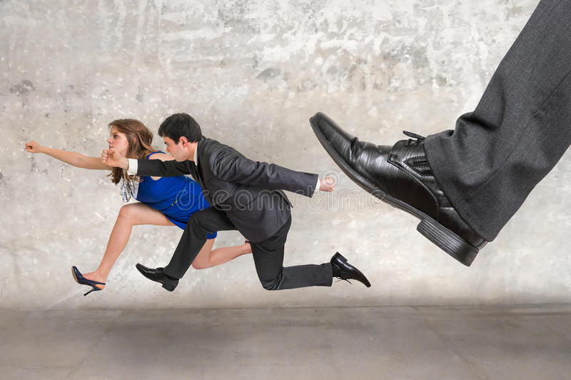 Small business woman and man together running away stock photography