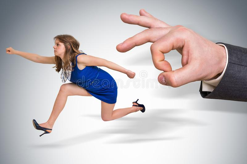 Small business woman running away from a boss pressure stock images